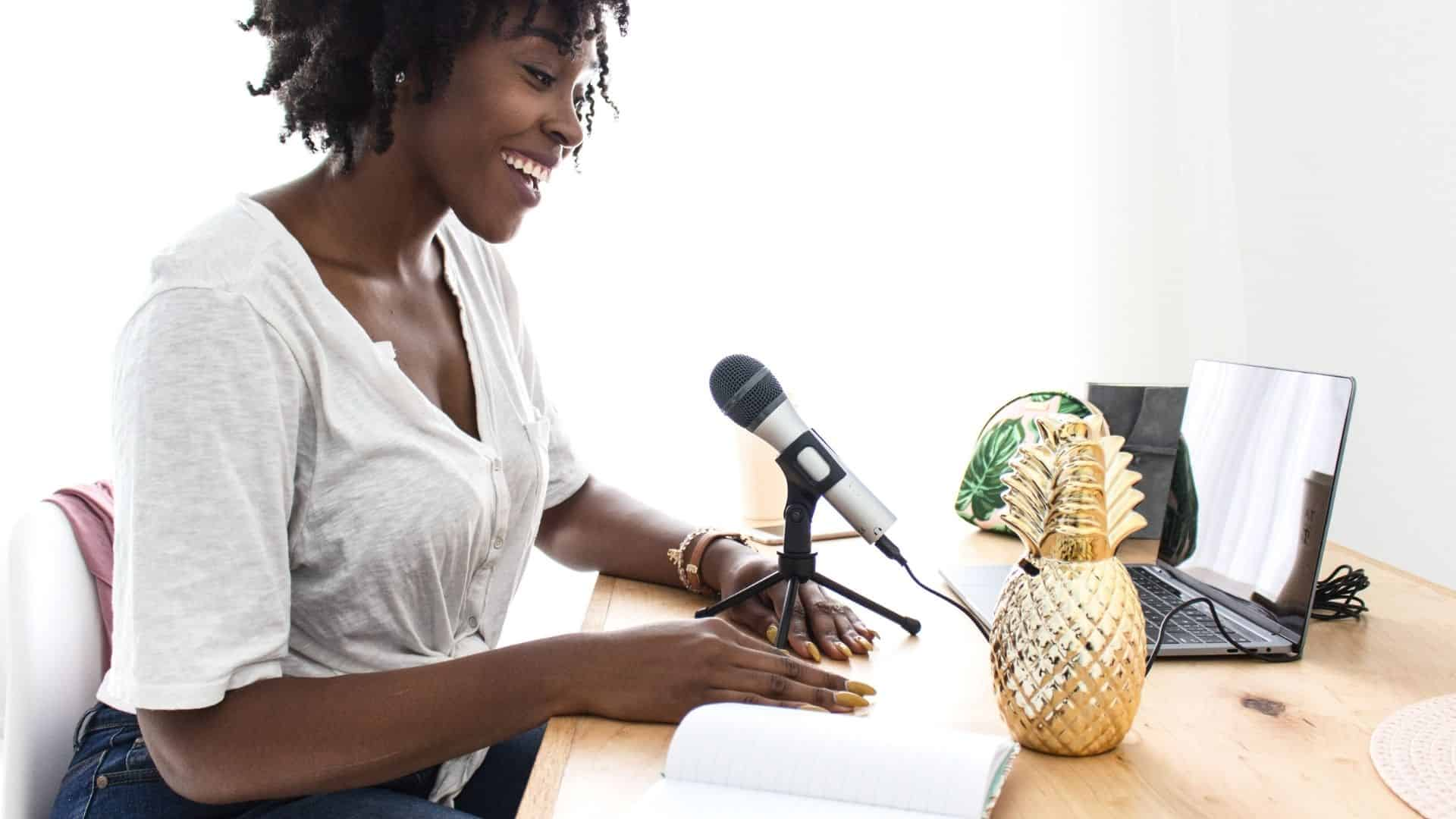 business woman doing a podcast with an ideal customer in mind