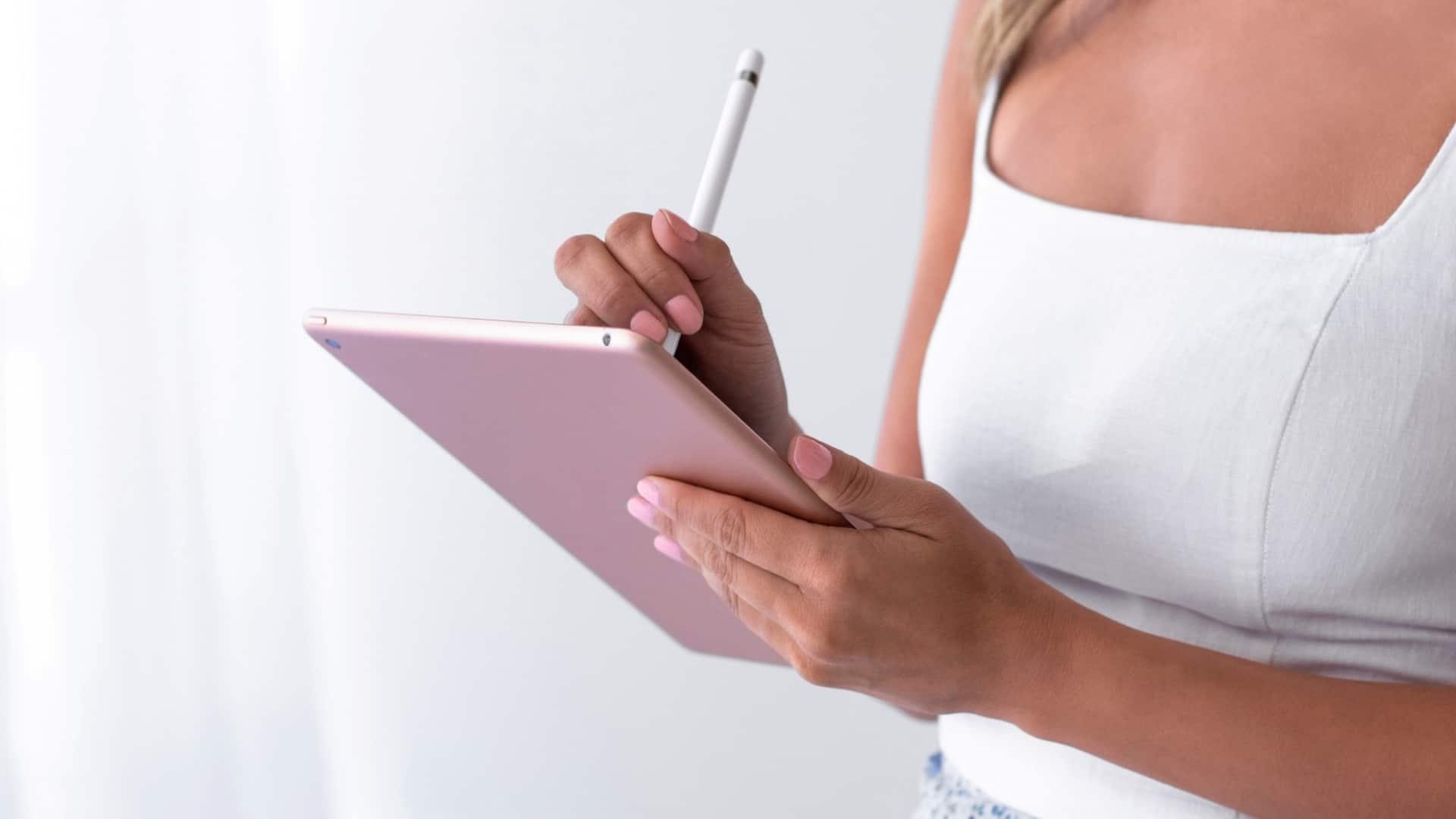 Female business owner designing her website on a laptop
