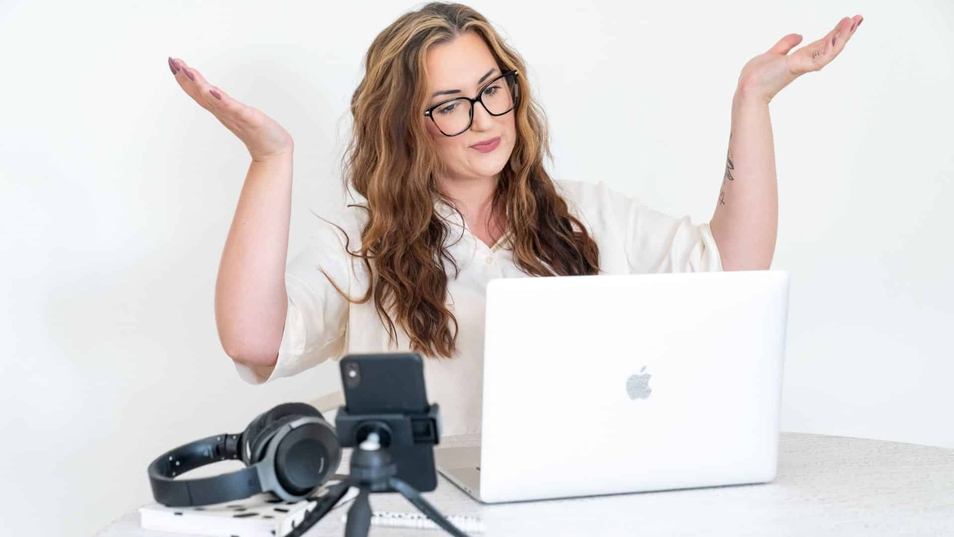 business woman throwing her hands up in the air learning about different website platforms