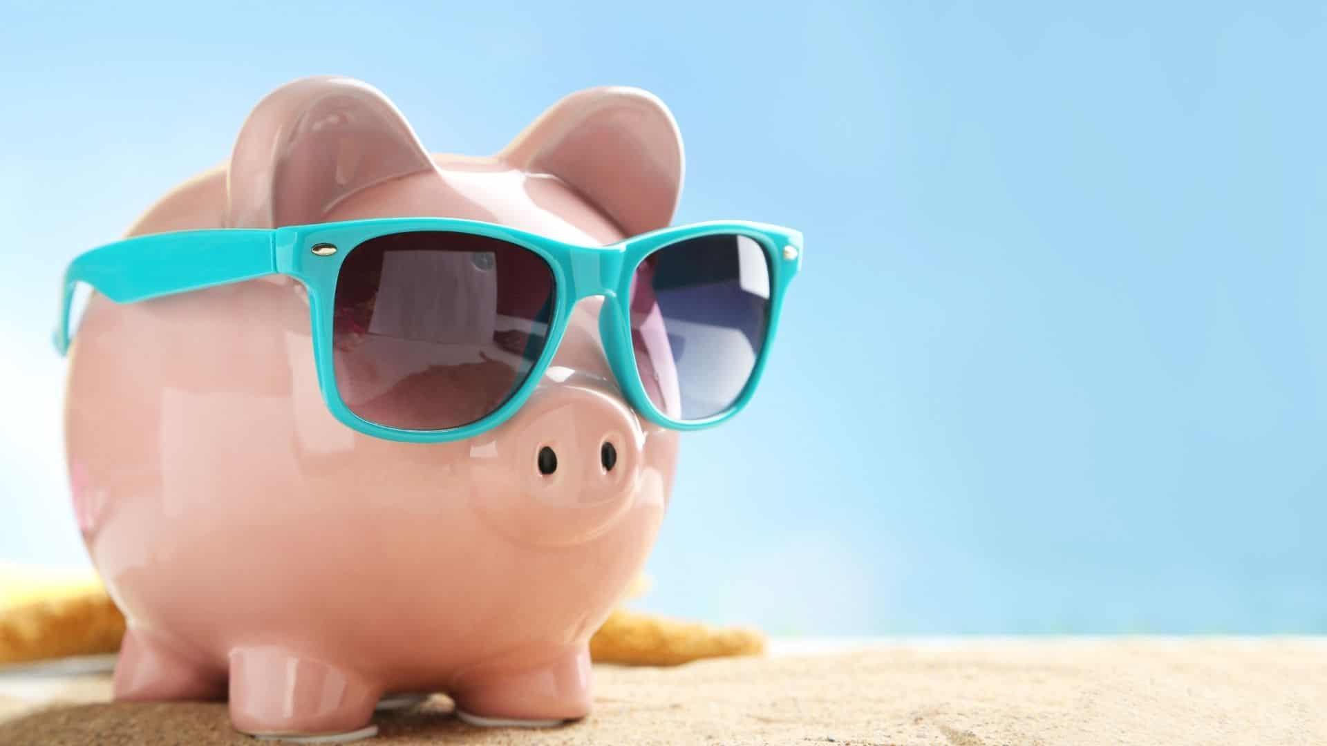 piggy bank with blue sunglasses