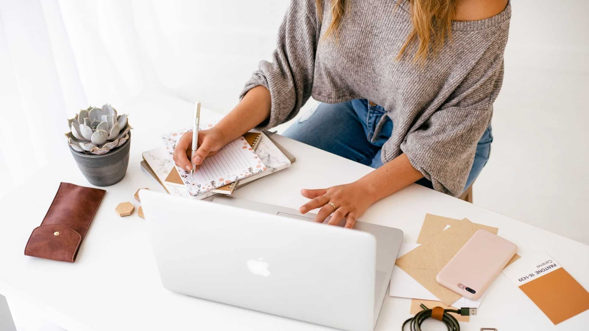 Woman writing her first blog post